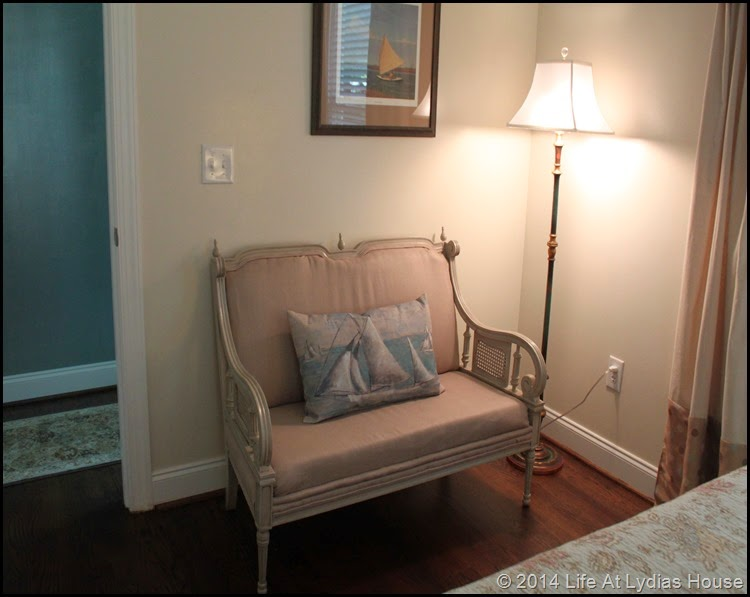 Settee and floor lamp