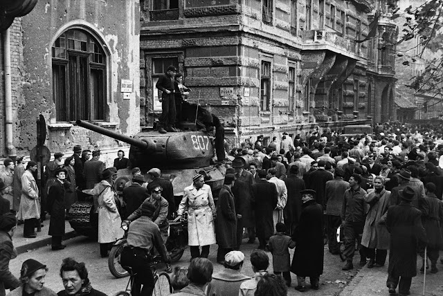1956, Hungary --- Crowds surround a captured Russian tank during the anti-Communist revolution in Hungary. --- Image by © Hulton-Deutsch Collection/CORBIS