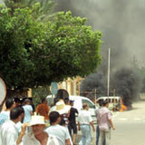 A car is set on fire on July 18, 2011 in Sidi Bouzid. A 14-year-old boy was killed on July 17 by a ricocheting bullet when police opened fire to break up a protest in Sidi Bouzid, the town where Tunisia's uprising erupted in December. AFP PHOTO / STR (Photo credit should read STR/AFP/Getty Images)