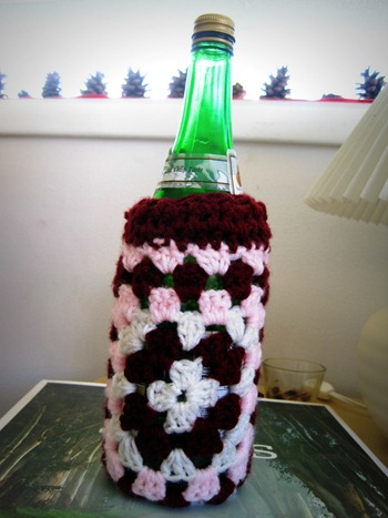 crocheted and knitted bottle cozy
