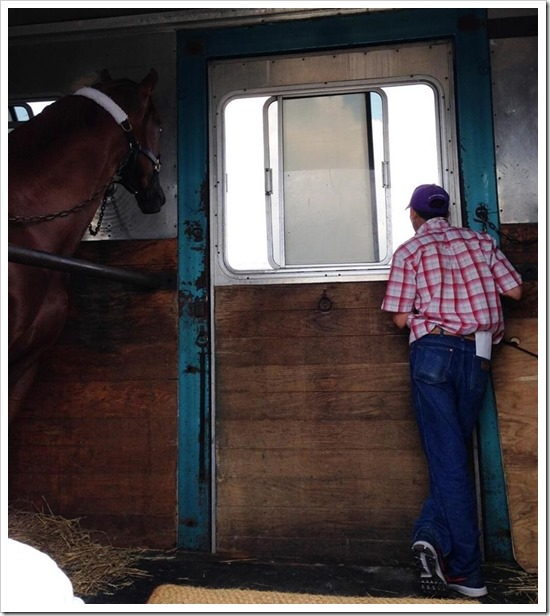 The Amazing RAUL RODRIGUEZ never far from his best friend, California Chrome, await their turn to board the plane for Maryland. Photo | Barkley Porter