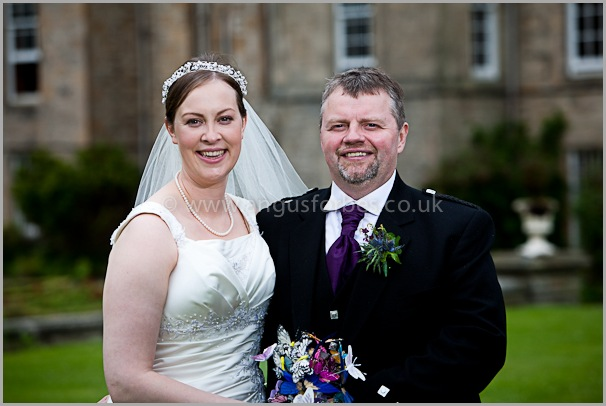 a smiling bride and groom in scotland