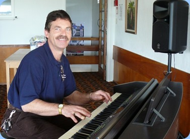 Peter Littlejohn playing the Clavinova. Photo courtesy of Dennis Lyons.