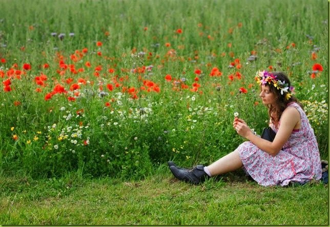 girl with flowers in her hair in meadow