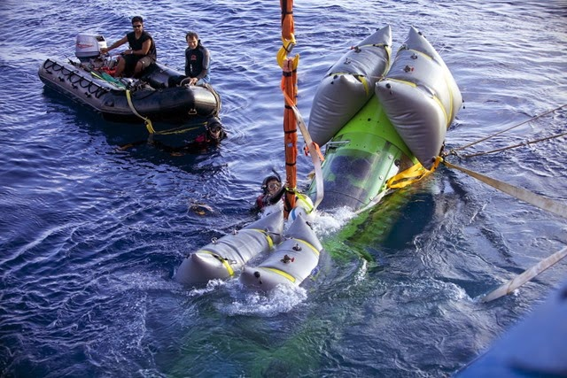 The DEEPSEA CHALLENGER piloted by James Cameron is lowered into the water at the beginning of a dive to 8,221 meters.
