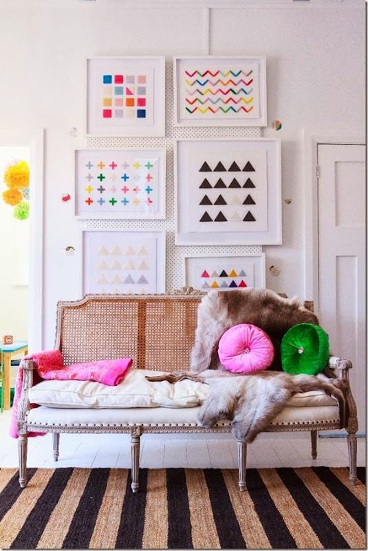 lovely gallery wall and pretty pops of color