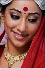 Bengali bride adorned with small bindis
