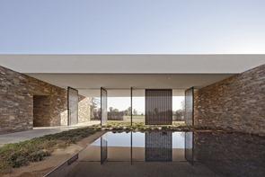 fachada-de-piedra-casa-moderna-xten-architecture