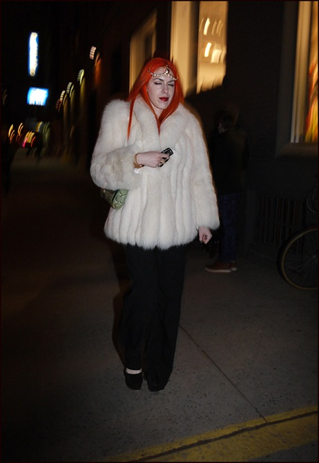 5 w white fur coat bright red hair black slacks ol
