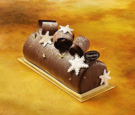 HAAGEN-DAZS CHOCOLATE COLYSEE log cake available in luxurious rich  Belgian Chocolate ice cream or irresistible Macadamia Nut ice cream, topped with chocolate curls, marshmallow star.