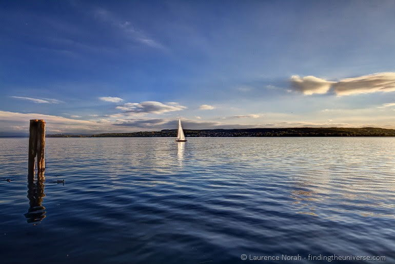 Sunset sailboat reflectiont on the bodensee
