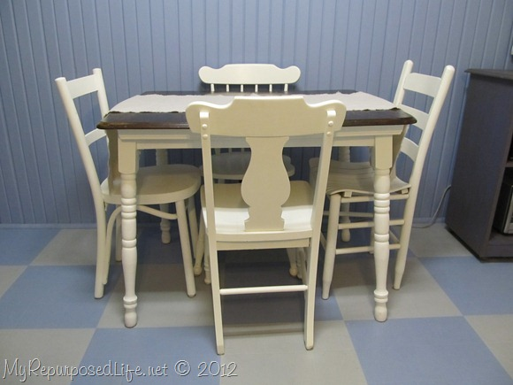old table with mismatched chairs