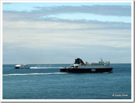 P&O fast ferry from Ireland passing a conventional ferry leaving Loch Ryan for Belfast or Larne.