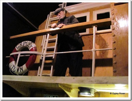 Skipper standing on the bridge checking all is ship shape before sailing.