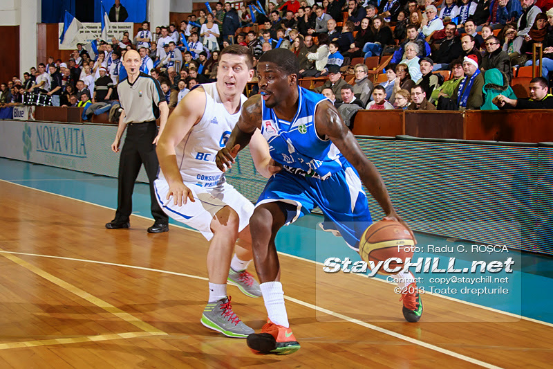 Vernon Taylor drives the ball against Silviu Lupusavei in the FIBA EuroChallenge game between BC Mures from Romania and Rilski Sportist from Bulgaria played at City Arena in Tirgu Mures on December 17th, 2013.