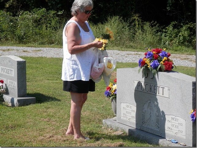 Placing flowers on Mom, Dad, Ricki and Vicki's Head Stone
