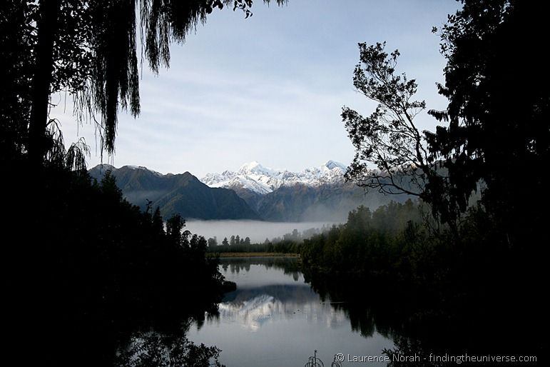 Mirror lake reflection Lake Matheson southern alps New Zealand
