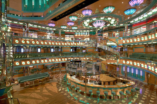 Carnival-Magic-Atrium-Magic-Bar - The Magic Bar, on deck 3 of Carnival Magic's atrium, is a perfect spot to meet friends for cocktails and people watching.