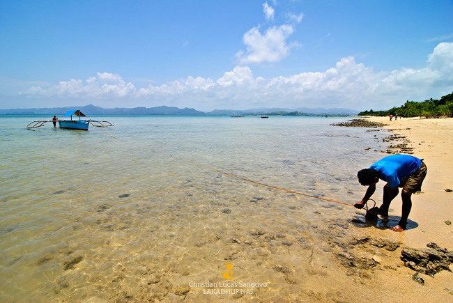 A Boatman Anchoring His Boat at Caramoan's Bagieng Island