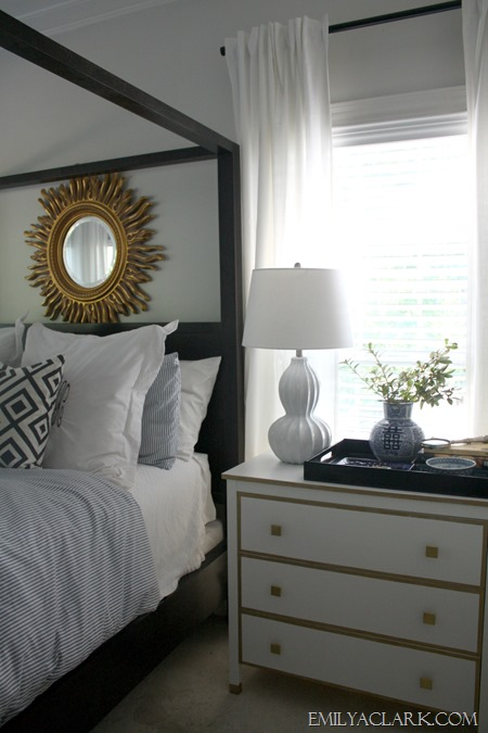 master bedroom with white and gold chest