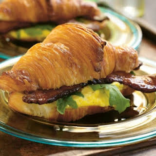 Suvir Saran's Warm Egg Salad on Croissants with Country Bacon and Arugula.
