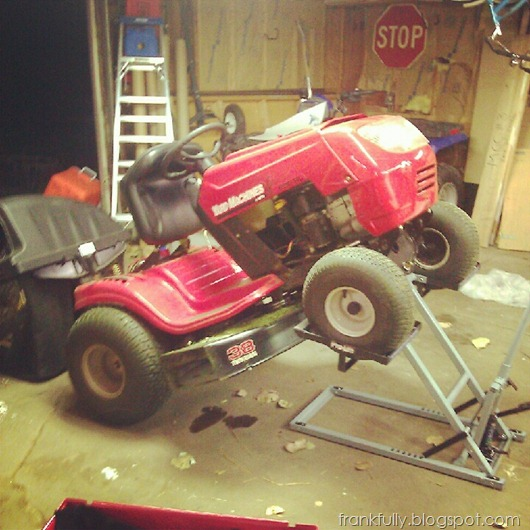 working on the lawn mower