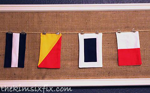 Nautical flags hung on line