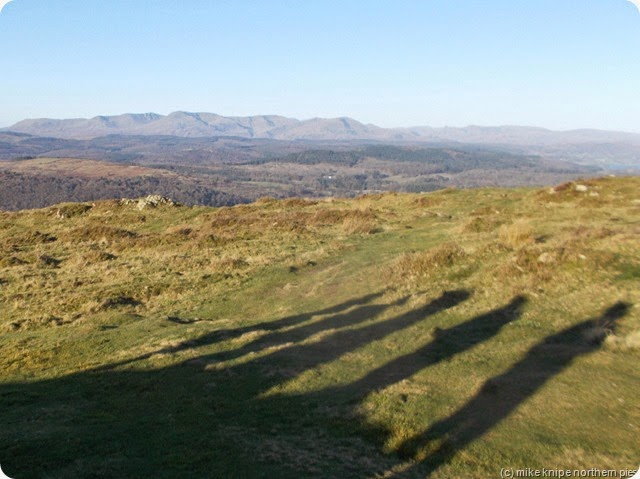 the shadows with supporting acts. Coniston fells in the distance