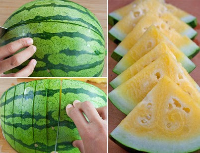 Cutting the watermelon in half and quarters and then into wedges