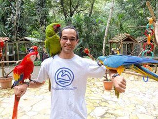 Me with birds at Macaw Mountain Bird Park In Copan Ruinas Honduras