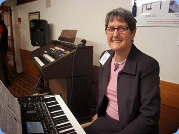 Ann Izzillo preparing to play her Korg Pa3X. Photo courtesy of Dennis Lyons