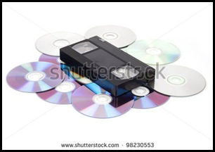 stock-photo-cd-vs-vhs-vhs-cassette-lay-on-the-many-cd-disks-98230553