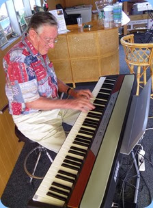 Roy Steen giving the Club's portable digital piano a whirl.