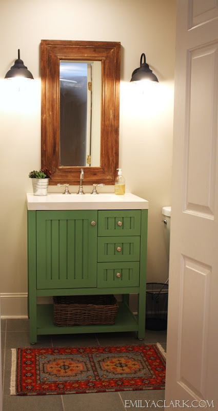 kids' bathroom with painted green vanity