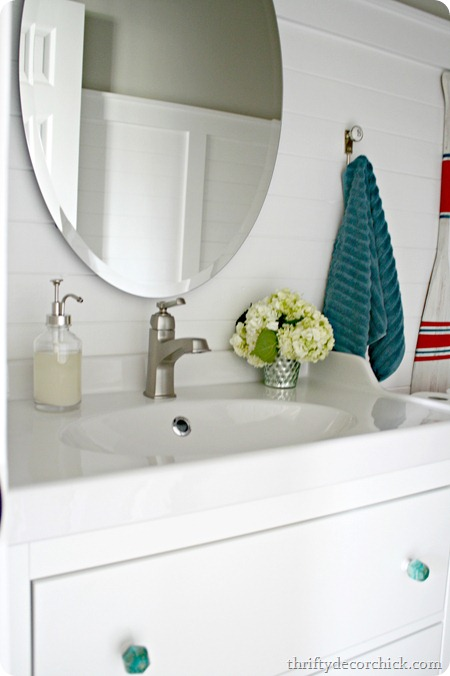 oval mirror over bathroom sink