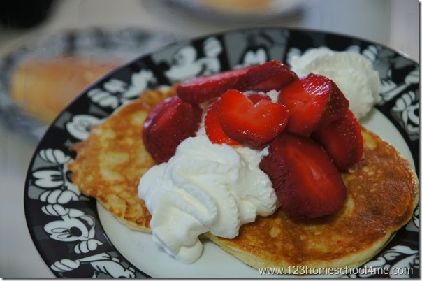 healthy pancake recipe made with almond flour homemade whip cream and strawberries