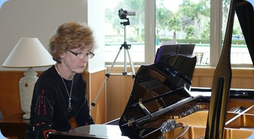 Denise Gunson playing a solo piece on the grand piano. Photo courtesy of Dennis Lyons.