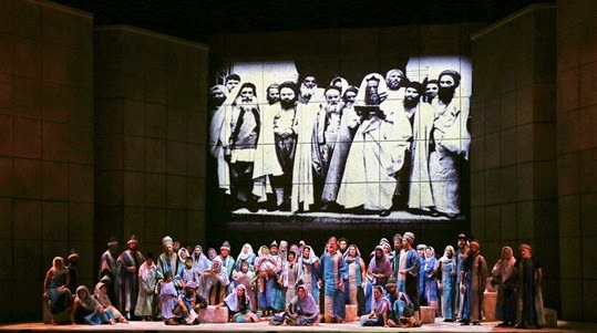 IN PERFORMANCE: the Opera Carolina Chorus performing 'Va, pensiero' in Verdi's NABUCCO at Opera Carolina [Photo by jonsilla.com, © 2014 by Opera Carolina]