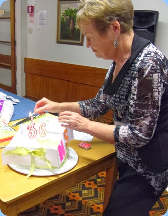 Our Catering Manager, Diane Lyons lighting the 'singing' Birthday candle to celebrate 36 years the Club has been in existence! Photo courtesy of Dennis Lyons.