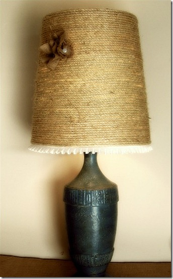 Updated lampshade wrapped in jute with burlap flowers and white pleated fabric trim