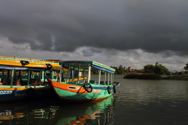 Boats at Hoi An's riverside ready to take you on a cruise