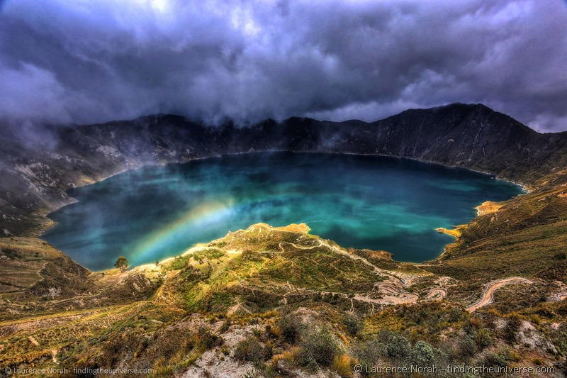 Quilotoa volcano crater and rainbow Ecuador