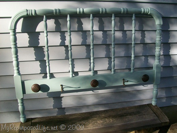 vintage spool headboard with vintage door knobs