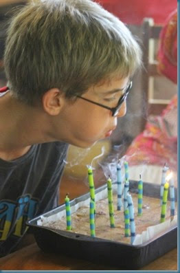 Benjamin blowing out candles