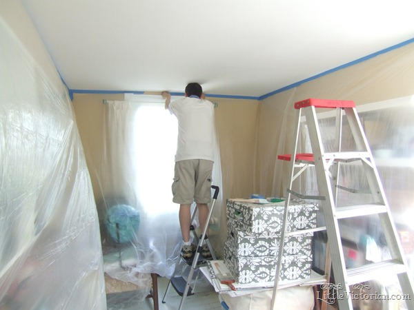 taping off for painting the ceiling