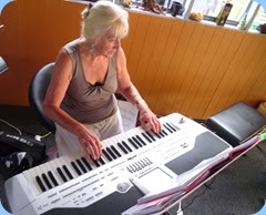 Delyse Whorwood, the Club Secretary,  making one of her rare musical forays on Yvonne Moller's Korg Pa1X