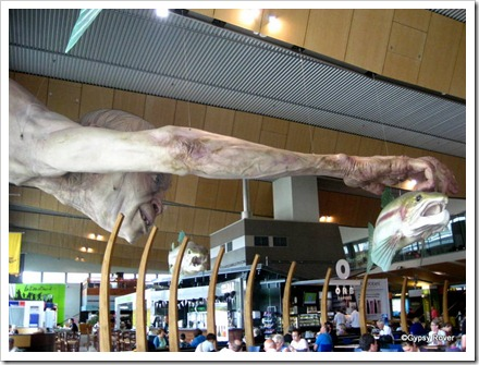 "Gollum catching his favourite food at Wellington Airport. Part of the publicity of the ""Hobbit"" movie."
