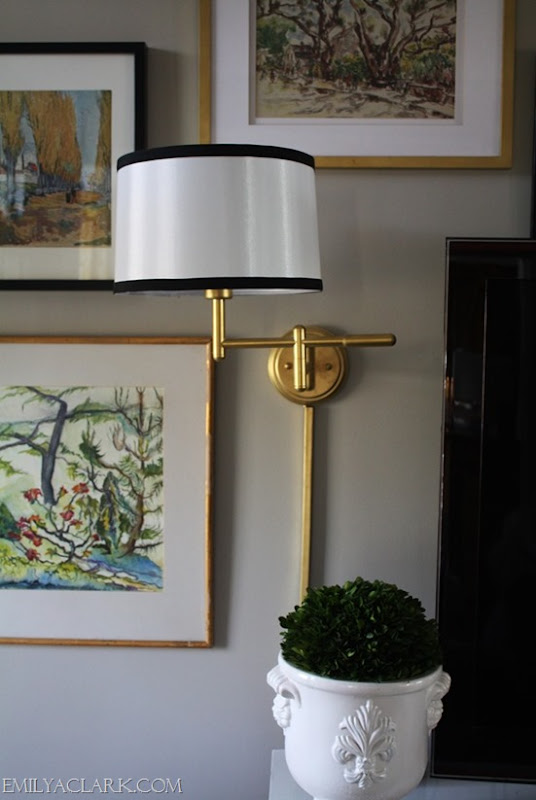 brass wall lamps in living room