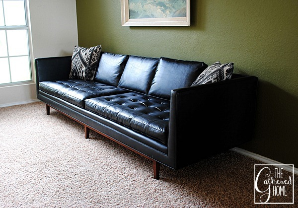 black mid century sofa