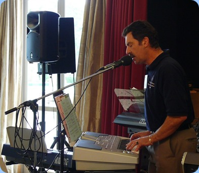 Peter Littlejohn playing and singing with his Korg Pa1X. Photo courtesy of Dennis Lyons.